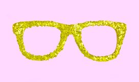 Luxury golden glasses with stars from confetti on pink background. Stock Images