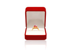 Luxury golden ring with diamond in red box. On a white background Royalty Free Stock Images
