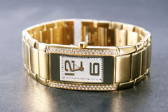 Luxury golden woman wristwatch Royalty Free Stock Images
