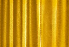 Luxury golden yellow silk curtain texture for background and design art work.  stock photos