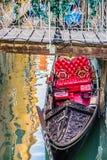 Luxury gondola under bridge, Venice, Italy Stock Images