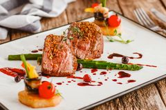 Luxury gourmet food veal recipe restaurant meal. Luxury gourmet food. Veal cooking recipe. Elegant expensive restaurant meal. Meat dish on plate royalty free stock photography