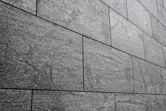 Luxury granite building wall. Perspective view of the modern granite slabs wall royalty free stock photo