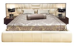 Luxury gray beige modern bed furniture with patterned bed with leather upholstery headboard . Soft velour fabric. Luxury beige modern bed furniture with Royalty Free Stock Photo