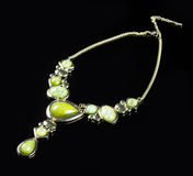 Luxury green necklace on black stand Stock Photography