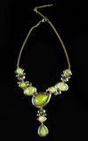 Luxury green necklace on black stand Royalty Free Stock Photos