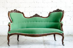 Luxury green vintage style armchair sofa couch in vintage room Stock Photo