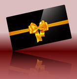 Luxury greeting card with golden bow on glossy black Stock Image