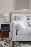 Luxury grey sofa on carpet in luxury bedroom Royalty Free Stock Photos
