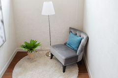 Luxury grey tweed sofa with blue pillow in living corner Stock Images