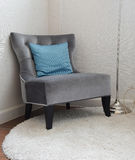 Luxury grey tweed sofa with blue pillow in living room Royalty Free Stock Photo