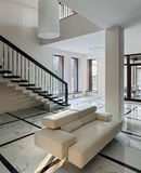 Luxury hall interior with staircase Royalty Free Stock Photos