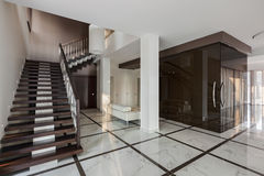 Luxury hall interior with staircase and glass wardrobe Royalty Free Stock Image
