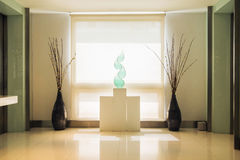 Luxury hallway with cyan fork of flame alike ornament on the mount Stock Image
