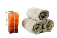 Luxury hand made soap with hand towel. Isolated colorful soaps with three hand towels Royalty Free Stock Image