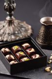 Luxury handmade chocolate candies with nuts in gift box Royalty Free Stock Images
