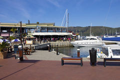 Waterfront harbour with harbour restaurant Royalty Free Stock Images