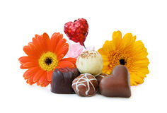 Luxury heart shaped chocolates with flowers royalty free stock photography