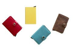 Luxury, high-end wallets/ card cases on white background. Leather/ metal card cases with metal buttons laying flat on a white background. These cases are royalty free stock photography