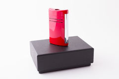 Luxury high gloss finished red lighter. High gloss red and silver lighter and box. Refillable stock images