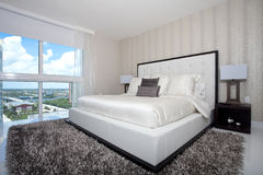 Luxury highrise bedroom Stock Image