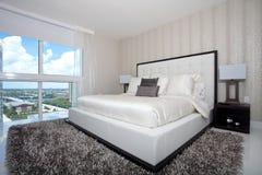 Luxury highrise bedroom Stock Image