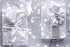 Luxury holiday gifts with white silk bow and ribbons on marble background, Christmas time surprise. New Years Eve celebration, winter decoration and Valentines royalty free stock images