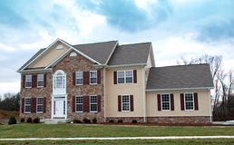 Luxury Home. Suburban home with stone and siding Stock Photos
