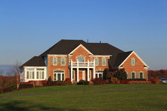 Luxury Home. On sunny blue sky background early morning Royalty Free Stock Photos