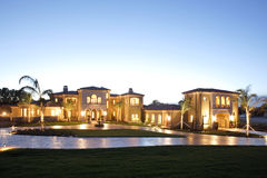 Luxury Home. A huge new luxury home at sunset Stock Photography