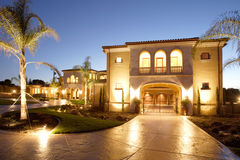 Luxury Home. A huge new luxury home at sunset Royalty Free Stock Images