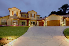 Luxury Home. A huge new luxury home at sunset Royalty Free Stock Photos