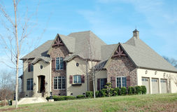 Luxury Home 60. A  two-story home on a large lot with unique eaves Stock Image