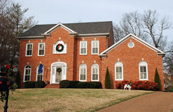 Luxury Home 74 with Spaniel. A  two-story brick home on a large lot. Dog in front of the house Stock Photos