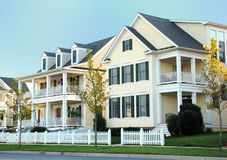 Luxury Home 79. Two-story yellow homes with siding an porches on both levels Stock Photos