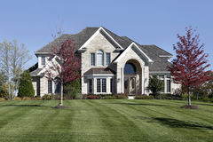 Luxury home with arched entry Stock Images