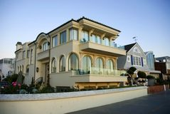 Luxury home with arched windows. Executive style luxury home with blue skies Royalty Free Stock Photos