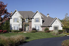 Luxury home with circular driveway Stock Photo