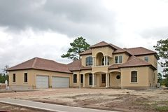 Luxury home construction 1. Newly constructed luxury home with three car garage Royalty Free Stock Photos