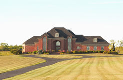Luxury Home in the Country. A beautiful brick upscale country estate in the early morning light Royalty Free Stock Image