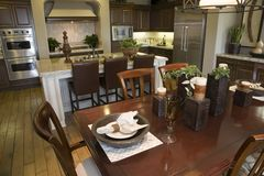 Luxury home dining room and kitchen. Stock Photos
