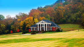 Luxury Home in the Fall. Beautiful luxury home on a hillside in the fall found in Tennessee, USA Stock Photo