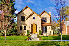 Luxury Home Front. All stone facade two story luxury home in Denver, Colorado, United States with view of front yard, and sidewalk Stock Images