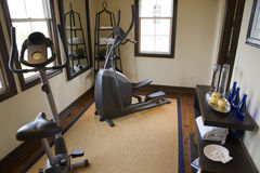 Luxury home gym. Luxury home gym with exercise equipment Stock Photography