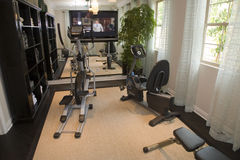 Luxury home gym. Luxury home gym with modern exercise equipment Royalty Free Stock Photography