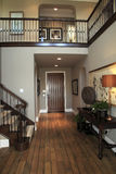 Luxury home hallway. Mansion hallway with a hardwood floor Royalty Free Stock Images