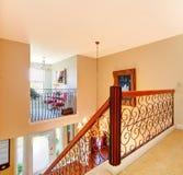 Luxury home hallway with metal railings. Stock Photo