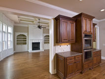 Luxury Home Interior Kitchen Cabinets. And Living Room with fireplace Stock Photo