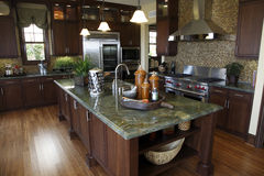 Luxury home kitchen. With a hardwood floor and granite island Stock Photos