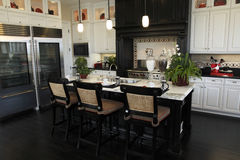 Luxury home kitchen. With a modern granite island Stock Images
